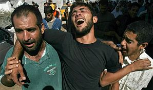 Relatives mourn during funeral procession in Beit Hanoun (AP).