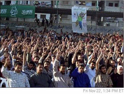 Hamas supporters raise their hands and chant Islamic slogans during a rally in Gaza City cheering the attack