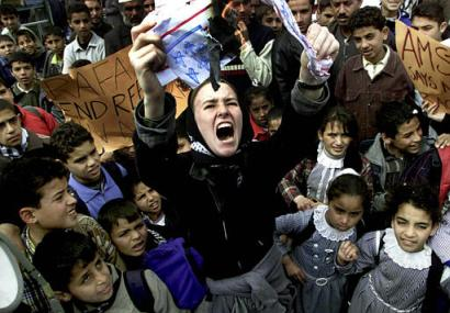 Rachel Corrie at a rally in southern Gaza, burning an American flag