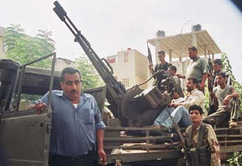 Suburban warfare: Hezbollah fighters are ready for action in a residential area.