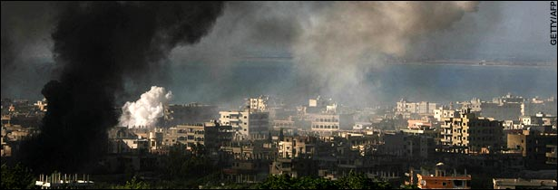 Heavy shelling leaves a dark plume of smoke over the Palestinian refugee camp.  (Daily Telegraph)