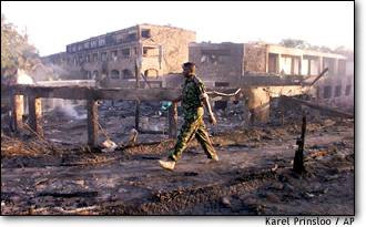A police officer patrols the destruction at the Paradise Hotel