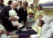 Prime Minister Sharon visits 8-year-old Haya Schijveschuurder, wounded in the Sbarro bombing.  Both of her parents were killed