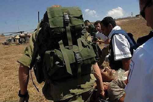 Soldiers evacuating a UN observer wounded by Hezbollah fire in South Lebanon. (Haaretz, July 23, 2006)